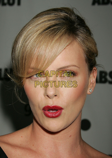 CHARLIZE THERON.The 17th Annual GLAAD Media Awards - Arrivals..Los Angeles, California, USA,.8 April 2006.portrait headshot red lips lipstick black dress funny face mouth pout pouting.Ref: ADM/RE.www.capitalpictures.com.sales@capitalpictures.com.©Russ Elliot/AdMedia/Capital Pictures.