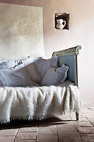 In the guest room the walls are painted a dusty rose- pink for the one behind the Louis XVI bed which is outlined in pearl-grey