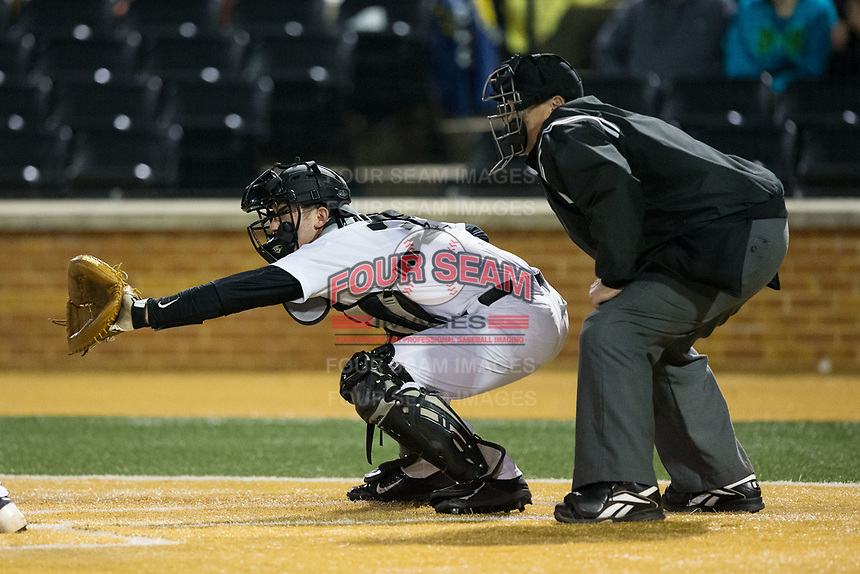 Wake Forest Demon Deacons catcher Ben Breazeale (39) sets a target as home plate umpire Randy Vestal looks on during game two of a double-header against the Kent State Golden Flashes at David F. Couch Ballpark on March 4, 2017 in Winston-Salem, North Carolina.  The Demon Deacons defeated the Golden Flashes 5-0.  (Brian Westerholt/Four Seam Images)