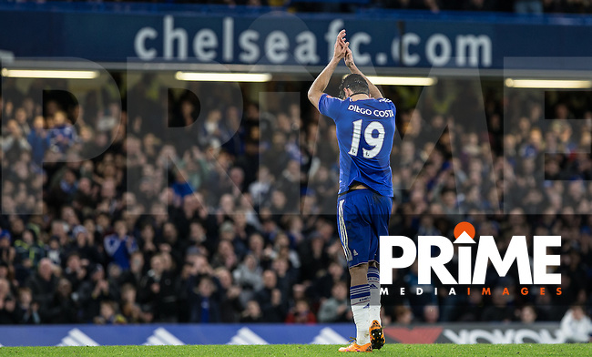 Diego Costa of Chelsea applauds the support as he leaves the field during the FA Cup 5th round match between Chelsea and Manchester City at Stamford Bridge, London, England on 21 February 2016. Photo by Andy Rowland.