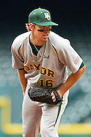 Relief pitcher Brooks Pinckard #16 of the Baylor Bears checks the runner at first before delivering a pitch to the plate against the Houston Cougars at Minute Maid Park on March 4, 2011 in Houston, Texas.  Photo by Brian Westerholt / Four Seam Images