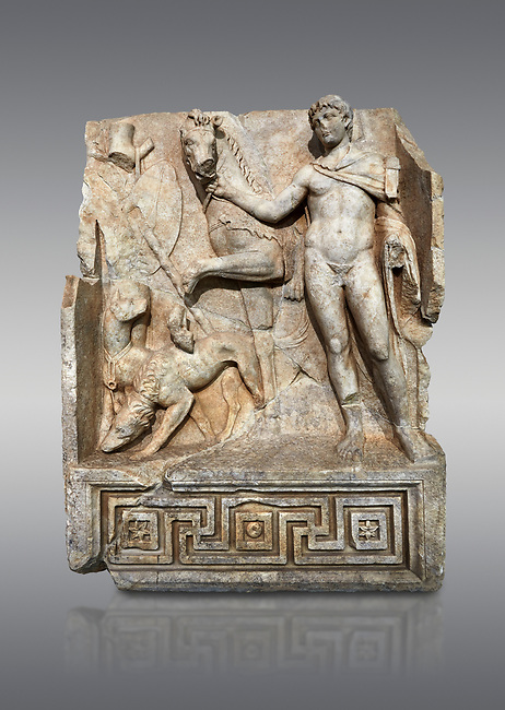 Roman Sebasteion relief  sculpture of Royal Hero with hunting dogs,  Aphrodisias Museum, Aphrodisias, Turkey. <br /> <br /> A diademed youth stands with his horse and hunting dogs. At the left an oval shield (foreign) hangs from a leafless tree, against which leans a long thin club. The Royal hero in this and the relief to the left is probably a local founder such as Assyrian King Ninos, claimed as founder of their city by the Aphrodisians.