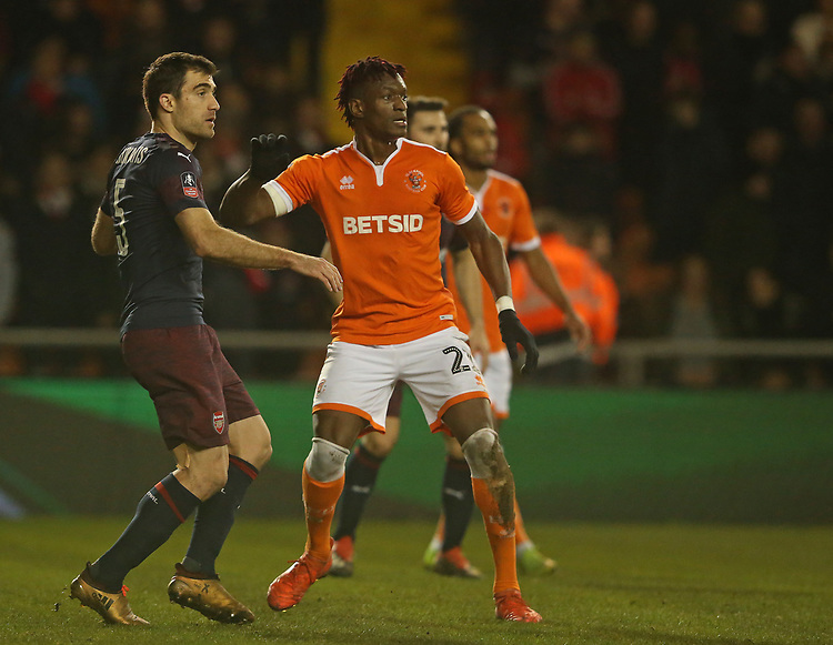 Blackpool's Armand Gnanduillet and Arsenal's Sokratis Papastathopoulos<br /> <br /> Photographer Stephen White/CameraSport<br /> <br /> Emirates FA Cup Third Round - Blackpool v Arsenal - Saturday 5th January 2019 - Bloomfield Road - Blackpool<br />  <br /> World Copyright © 2019 CameraSport. All rights reserved. 43 Linden Ave. Countesthorpe. Leicester. England. LE8 5PG - Tel: +44 (0) 116 277 4147 - admin@camerasport.com - www.camerasport.com