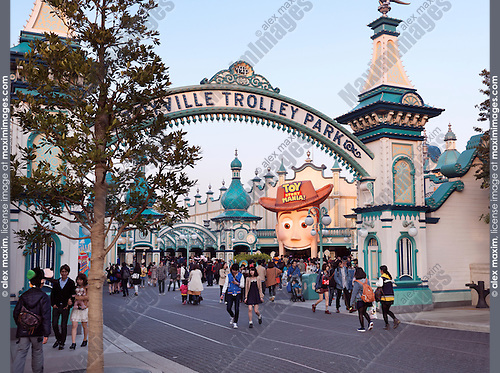 People at Toyville trolley park, Toy Story themed attraction at Tokyo Disneysea. Japan.