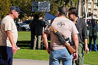 "Phoenix, Arizona. January 19, 2013 - A protester displays a rifle gun during Saturday's rally in Phoenix to oppose potential new laws that would limit access to guns and ammunition in the United States, among other regulations proposed. As President Barack Obama proposed new gun regulations last week, gun owners demonstrated against it with national ""Guns Across America"" rallies to defend the Second Amendment. Dozens showed up at the Arizona State Capitol, many of them carrying weapons. Photo by Eduardo Barraza © 2013"