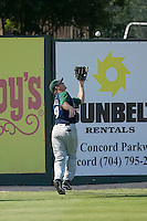 Left fielder Brandon Barnes (19) of the Lexington Legends chases down a fly ball at Fieldcrest Cannon Stadium in Kannapolis, NC, Sunday June 15, 2008.