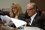 Nevada Assemblywoman Jill Dickman, R-Sparks, and Sen. David Parks, D-Las Vegas, work in committee at the Legislative Building in Carson City, Nev., on Tuesday, May 5, 2015.<br />