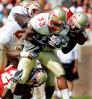 TALLAHASSEE, FLA. 4/16/11-FSUG&G041611 CH-Garnet's Dan Hicks, right, and Telvin Smith drag down Gold's Ty Jones during first half action in the Florida State University Garnet and Gold game Saturday in Tallahassee..COLIN HACKLEY PHOTO