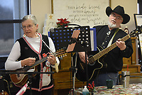 NWA Democrat-Gazette/FLIP PUTTHOFF <br /> SONGS OF THE SEASON<br /> Mary Bourn plays 8-string ukelele Tuesday Dec. 4 2018 while Randy Cannon plays bass with the Old Town String Band at the Billy V. Hall Senior Activity and Wellness Center in Gravette. The band features musicians on guitar, mandolin, fiddle, ukelele, bass and more. They play at the Gravette senior center at 10 a.m. the first, second and third Tuesday of each month