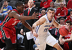 SIOUX FALLS, SD - MARCH 5:  Max Landis #10 of Fort Wayne drives past Kason Harrell #32 of South Dakota in the 2016 Summit League Tournament. (Photo by Dick Carlson/Inertia)