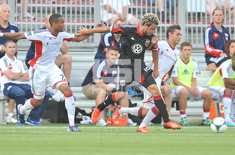 Nick DeLeon (18) of D.C. United goes against Diego Fagundez (14) right and Darrius Barnes (25) left of the New England Revolution. D.C. United defeated the The New England Revolution 3-1 in the Quarterfinals of Lamar Hunt U.S. Open Cup, at the Maryland SoccerPlex, Tuesday June 26 , 2013.