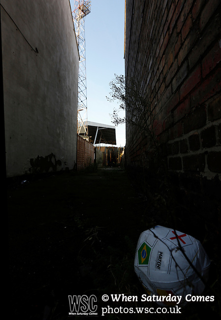 Grimsby Town 1 Lincoln City 3, 28/12/2014. Blundell Park, Football Conference. Deflated 2014 World Cup beach ball in an alley near Blundell Park. Like many late victorian football grounds, Blundell Park is surrounded by terraced houses.  Photo by Paul Thompson.