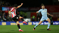 Christian Norgaard of Brentford in action as Kalvin Phillips of Leeds United looks on during Brentford vs Leeds United, Sky Bet EFL Championship Football at Griffin Park on 11th February 2020