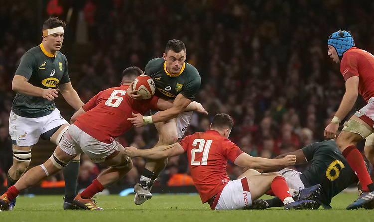 South Africa's Jesse Kriel is tackled by Wales' Ellis Jenkins<br /> <br /> Photographer Ian Cook/CameraSport<br /> <br /> Under Armour Series Autumn Internationals - Wales v South Africa - Saturday 24th November 2018 - Principality Stadium - Cardiff<br /> <br /> World Copyright © 2018 CameraSport. All rights reserved. 43 Linden Ave. Countesthorpe. Leicester. England. LE8 5PG - Tel: +44 (0) 116 277 4147 - admin@camerasport.com - www.camerasport.com