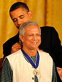 Washington, DC - August 12, 2009 -- United States President Barack Obama (R) President Barack Obama presents founder of the Grameen Bank in Bangladesh and a global leader in micro-credit Dr. Muhammad Yunus the 2009 Medal of Freedom, America's highest civilian award, in the East Room of the White House in Washington, DC, USA August 12, 2009.       .Credit: Mike Theiler - CNP