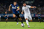 (L) Andrea Ranocchia of FC Internazionale Milano competes for the ball with (R) Jese Rodriguez of Real Madrid CF during the FC Internazionale Milano vs Real Madrid  as part of the International Champions Cup 2015 at the Tianhe Sports Centre on 27 July 2015 in Guangzhou, China. Photo by Aitor Alcalde / Power Sport Images