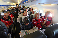 Wednesday 07 August 2013<br /> Pictured: Alan Curtis (R) and goalkeeping coach Adrian Tucker (2nd R) chatting on the aeroplane en route to Malmo.<br /> Re: Swansea City FC travelling to Sweden for their Europa League 3rd Qualifying Round, Second Leg game against Malmo.
