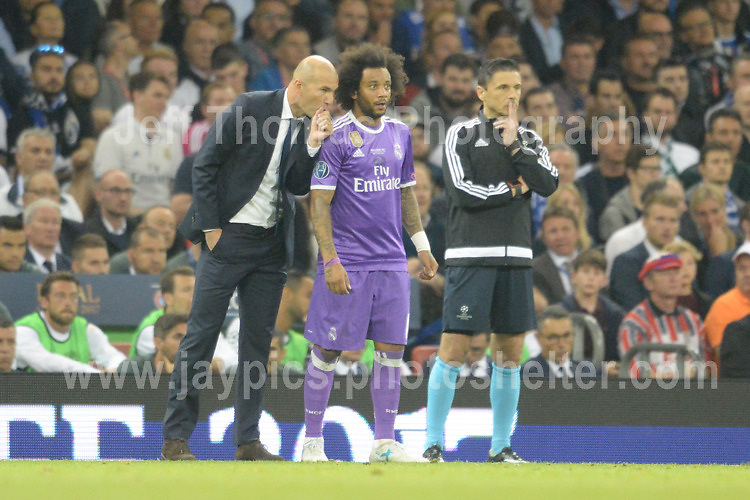 Real Madrid coach Zinedine Zidane giving instructions to Marcelo of Real Madrid during the UEFA Champions league final  between Juventus and Real Madrid at the National Stadium of Wales on Saturday 3rd June 2017<br /> <br /> <br /> Jeff Thomas Photography -  www.jaypics.photoshelter.com - <br /> e-mail swansea1001@hotmail.co.uk -<br /> Mob: 07837 386244 -