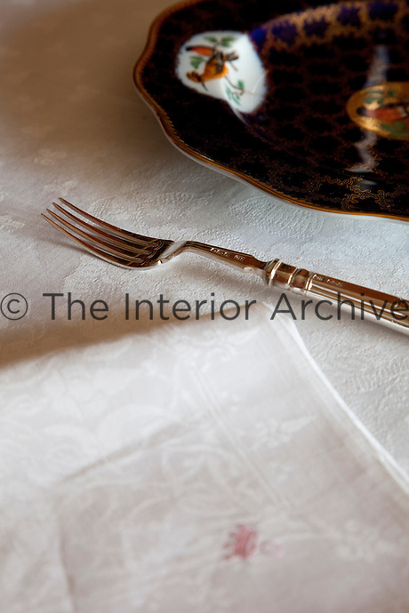 A silver fork neatly placed on the dining table laid ready for a dinner party