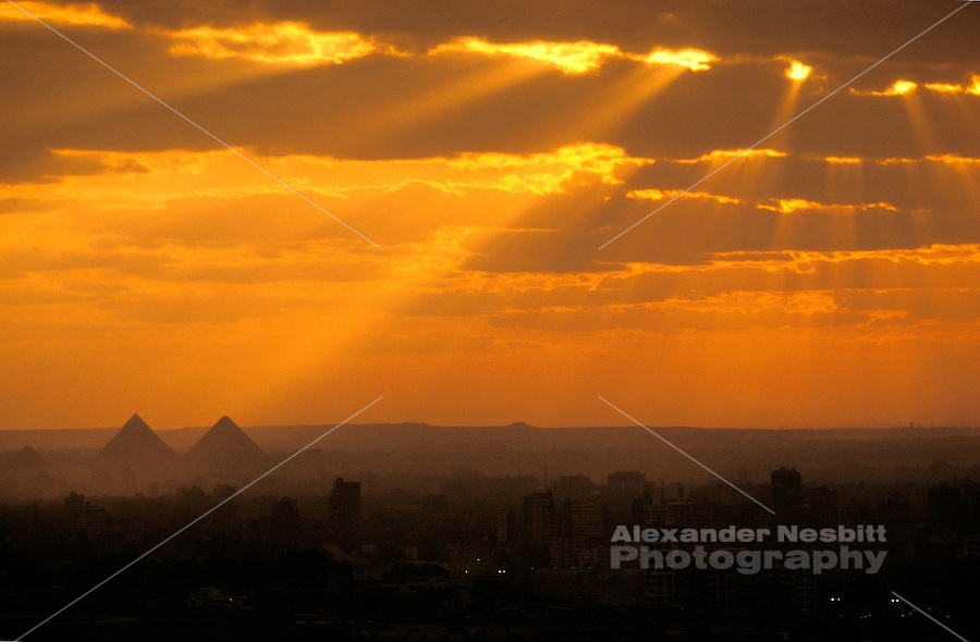 Egypt, 2000 - View over Cairo to the pyramids at Giza from the minaret of a ruinied mosque on the Moquatum cliffs.