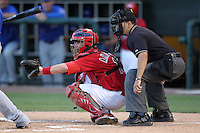 Memphis Redbirds catcher Bryan Anderson #16 and umpire Angel Campos during a game versus the Round Rock Express at Autozone Park on April 29, 2011 in Memphis, Tennessee.  Round Rock defeated Memphis by the score of 5-4 in 13 innings.  Photo By Mike Janes/Four Seam Images