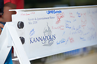 Fans sign the final steel beam that will be part of the Kannapolis Sports & Entertainment Venue that will open in time for the 2020 South Atlantic League season at Kannapolis Intimidators Stadium on May 19, 2019 in Kannapolis, North Carolina. (Brian Westerholt/Four Seam Images)