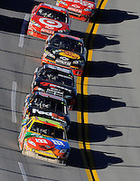 Nov. 1, 2009; Talladega, AL, USA; NASCAR Sprint Cup Series driver Kyle Busch (18) leads teammate Denny Hamlin (11) during the Amp Energy 500 at the Talladega Superspeedway. Mandatory Credit: Mark J. Rebilas-