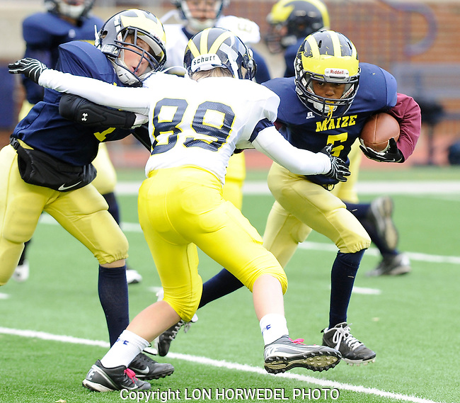 Washtenaw Junior Wolverines Maize vs Blue football games at Michigan Stadium, Saturday, October 26, 2013.