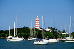 Bahamas: Hopetown Lighthouse near Abaco, boats in harbor.  Photo: bahcol101.Photo copyright Lee Foster, 510/549-2202, lee@fostertravel.com, www.fostertravel.com