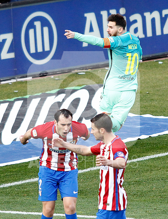 FC Barcelona's Leo Messi celebrates goal in presence of Atletico de Madrid's Diego Godin (l) and Gabi Fernandez dejected during La Liga match. February 26,2017. (ALTERPHOTOS/Acero)
