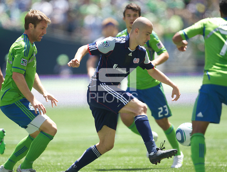 New England Revolution forward Rajko Lekic gets control of the during play against the Seattle Sounders FC at .CenturyLink Field in Seattle Sunday June 26, 2011. The Sounders won the game 2-1.   during play between the Seattle Sounders FC and the New England Revolution at .CenturyLink Field in Seattle Sunday June 26, 2011. The Sounders won the game 2-1.