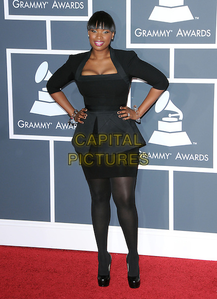 JENNIFER HUDSON.Arrivals at the 52nd Annual GRAMMY Awards held at The Staples Center in Los Angeles, California, USA..January 31st, 2010.grammys full length black dress skirt peplum hands on hips.CAP/RKE/DVS.©DVS/RockinExposures/Capital Pictures