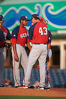 Hagerstown Suns pitching coach Sam Narron (43) talks with pitcher Luis Reyes during a game against the Lexington Legends on May 22, 2015 at Whitaker Bank Ballpark in Lexington, Kentucky.  Lexington defeated Hagerstown 5-1.  (Mike Janes/Four Seam Images)