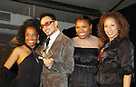 """Another World's Rhonda Ross presents the Hearts of Gold Hero Award to Johnny Dynell and poses with Deb Koenigsberger (event chair) and Tamara Tunie (mistress of ceremonies) at The Fourteenth Annual Hearts of Gold Gala """"Hooray for Hollywood!"""" - with its mission to foster sustainable change in lifestyle and levels of self-sufficiency for homeless mothers and their children on October 28, 2010 at the Metropolitan Pavillion, New York City, New York. (Photo by Sue Coflin/Max Photos)"""