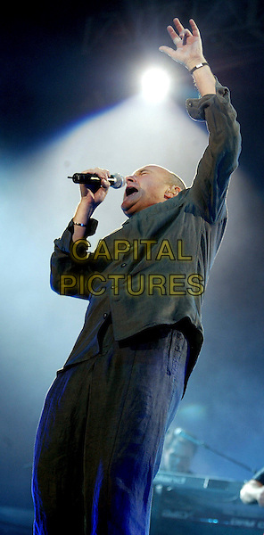 PHIL COLLINS.During his First Final Farewell World Tour in the Amsterdam ArenA..June 19th, 2004.Ref: SH.stage music gig performance live half length grey gray green shirt concert singing.www.capitalpictures.com.sales@capitalpictures.com.©Capital Pictures