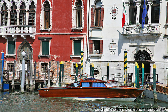 Venice is a World Heritage site that is perpetually filled with visitors from around the world. The Grand Canal is filled with classy looking water taxis and private boats.