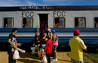 TRINIDAD, CUBA - MAY 10: Cuban people get off during the trip from Trinidad to Iznaga on May 10, 2018. in Cuba. Ferrocarriles de Cuba, is one of the oldest railroad around world, having opened its first route in 1837 with at least 17-mile long. Now the railway probably could cover more than 2,600 miles along the Island.  (Photo by Eliana Aponte/VIEWpress)