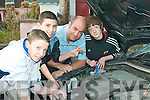 Motor fun: David O'Connor, Jake Moriarty and Kenneth Kelliher with KDYS Youth Worker Gareth Harteveld who are all ready to take part in the first Car Mechanics Course for teens at the Listowel centre this March.