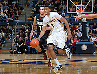 December 29th, 2012: California's Tyrone Wallace dribbles away from Harvard defender during a game at Haas Pavilion in Berkeley, Ca Harvard defeated California 67 - 62