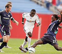 The New England Revolution's Steve Ralston watches as D.C. United's Freddy Adu gets past the tackle of Shalrie Joseph. The New England Revolution and D.C. United finished in a scoreless tie in MLS play at Gillette Stadium, Foxboro, MA on Saturday August 28, 2004.