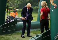 United States President Donald J. Trump swings a golf club during the White House Sports and Fitness Day on the South Lawn on May 30, 2018 in Washington, DC.<br /> CAP/MPI/RS<br /> &copy;RS/MPI/Capital Pictures
