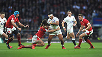Manu Tuilagi of England is tackled by Josh Navidi of Wales during the Guinness Six Nations match between England and Wales at Twickenham Stadium on Saturday 7th March 2020 (Photo by Rob Munro/Stewart Communications)