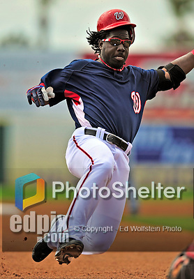 8 March 2009: Washington Nationals' outfielder Lastings Milledge slides safely into third after hitting a first-inning triple in a Spring Training game against the New York Mets at Space Coast Stadium in Viera, Florida. The Nationals defeated the Mets 8-3 in the Grapefruit League matchup. Mandatory Photo Credit: Ed Wolfstein Photo