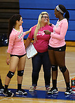 From left, Marymount's Kelsey Sanna, Courtney Phung and Morgan McAlpin talk on the sidelines during a college volleyball match against Shenandoah at Marymount University in Arlington, Vir., on Tuesday, Oct. 8, 2013.<br /> Photo by Cathleen Allison