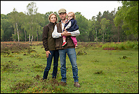 BNPS.co.uk ()1202 558833)<br /> Pic: PhilYeomans/BNPS<br /> <br /> Commoner Erica Dovey(37) with partner Tim Goldfinch and daughter Bella.<br /> <br /> A David and Goliath struggle is developing in the ancient New Forest between its Commoners, whose rights date back to the 13th century, and Forestry England.<br /> <br /> A public body has been accused of threatening the future of the New Forest by charging 'extortionate' rents to young commoners who help to maintain it.<br /> <br /> Forestry England has come under fire for charging full market rents on 65 Crown properties which, for over a century, have been set aside for commoners, the group of people with ancient rights to graze ponies and cattle in the Hampshire national park.<br /> <br /> Monthly rents which ranged from £300 to £500 have shot up to between £1,450 and £2,000, making them 'completely unaffordable' for commoners, it is claimed.<br /> <br /> As a result, it is feared a 'whole generation' of young commoners will be forced to leave the forest, with 'lasting consequences' for the conservation of the precious landscape.<br /> <br /> The rent increases have been imposed despite the government stipulating they could only be set at 15 per cent of a commoners' monthly income in the Illingworth Report (1992), according to the New Forest Commoners Defence Association.