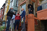 October 30, 2012  (Washington, DC)  D.C. Mayor Vincent Gray (left) tours Hurricane Sandy storm damage and meets residents in the Bloomingdale neighborhood. This area often floods during rainstorms.    (Photo by Don Baxter/Media Images International)
