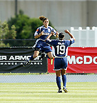 19 June 2004: Mia Hamm (9) and Angela Hucles (19) celebrate after Hamm's goal in the 3rd minute had given the Freedom a 1-0 lead. The Washington Freedom tied the Boston Breakers 3-3 at the National Sports Center in Blaine, MN in Womens United Soccer Association soccer game featuring guest players from other teams.