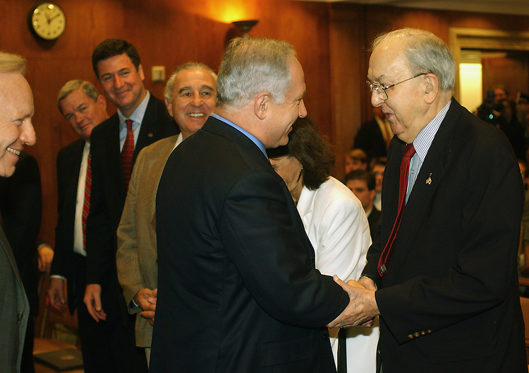 4/10/02.FORMER ISRAELI PRIME MINISTER NETANYAHU ADDRESSES SENATORS ON MIDDLE EAST CRISIS--Former Israeli Prime Minister Benjamin Netanyahu, middle, is greeted by Sen. Jesse Helms, R-N.C., right, Sen. Joseph I. Lieberman, D-Conn., far left, Sen. Christopher S. Bond, R-Mo., Sen. George Allen, R-Va., and Sen. Ben Nighthorse Campbell, R-Colo., before his address to Senate Intelligence members and other senators..CONGRESSIONAL QUARTERLY PHOTO BY SCOTT J. FERRELL
