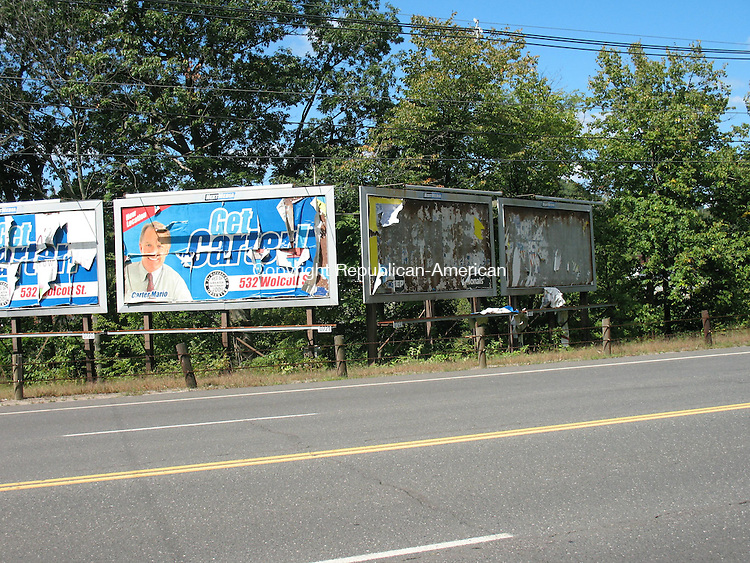 WATERBURY, CT - The Waterbury Police Community Relations Division and Blight Enforcement issued a blight summons to Next Media on Friday for failing to maintain these billboards on South Main Street where the paper has fallen off and is coming down.