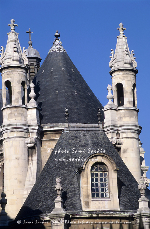 Architectural features on a rooftop of a church near Le Louvre, Paris, France.